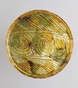 Collection: Spinnings - 4th Picture<br><br>Spiral decoration, detail from a bowl, brown and green sgraffito ware, Mediaeval period, 14th century.